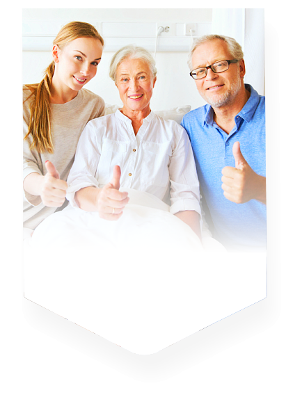 elderly couple and staff showing their thumbs up