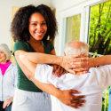 caregiver assisting elder man doing exercise