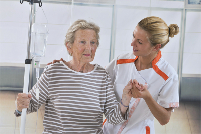 nurse walking next to a patient